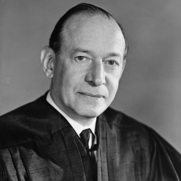 A black and white photo of a man in judges robes.