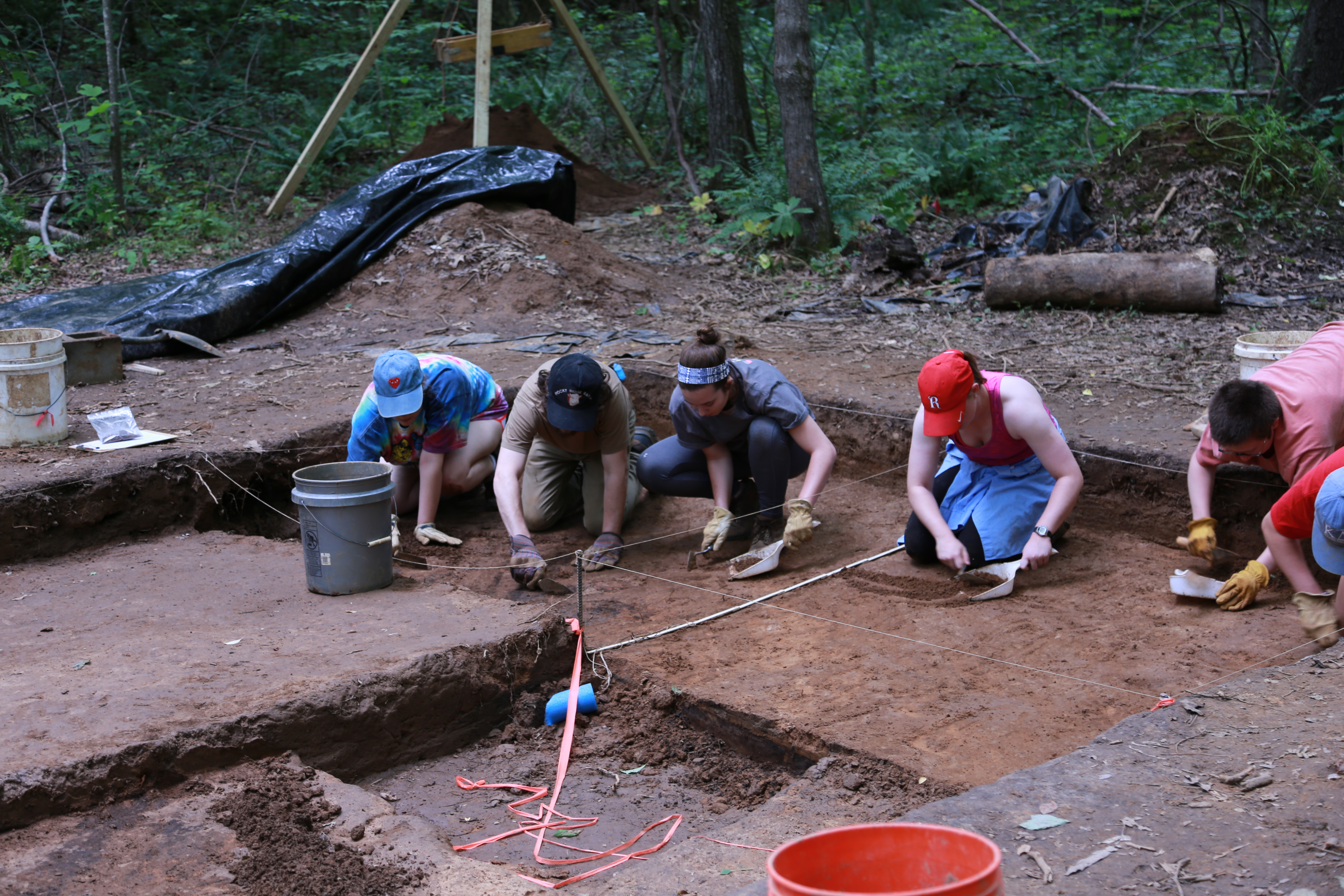 students digging at an archeological site