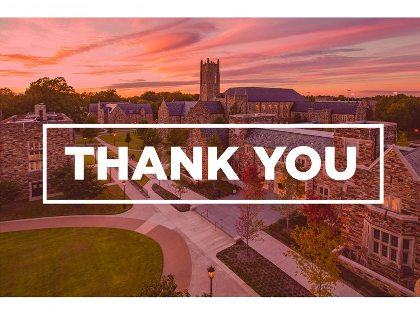 "The words 'Thank You"" with a scenic college campus in the background"