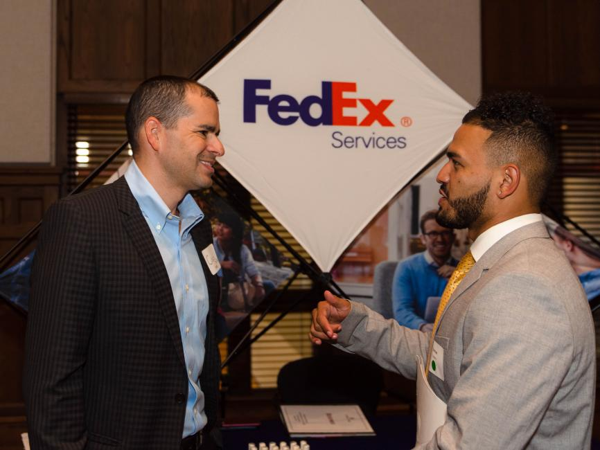 student engaging with a recruiter at a career fair