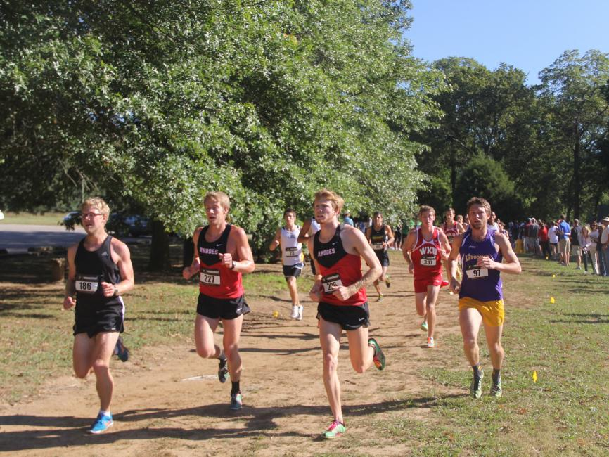 Photo of Rhodes College Track team members during a race.