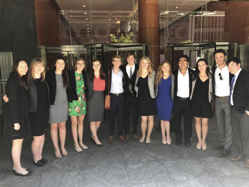 A group of diverse college students in professional business attire