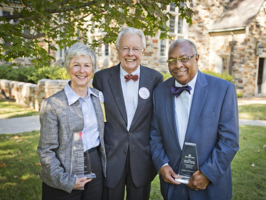 three older Rhodes alumni holding their awards: one woman, one white man, and one African American man