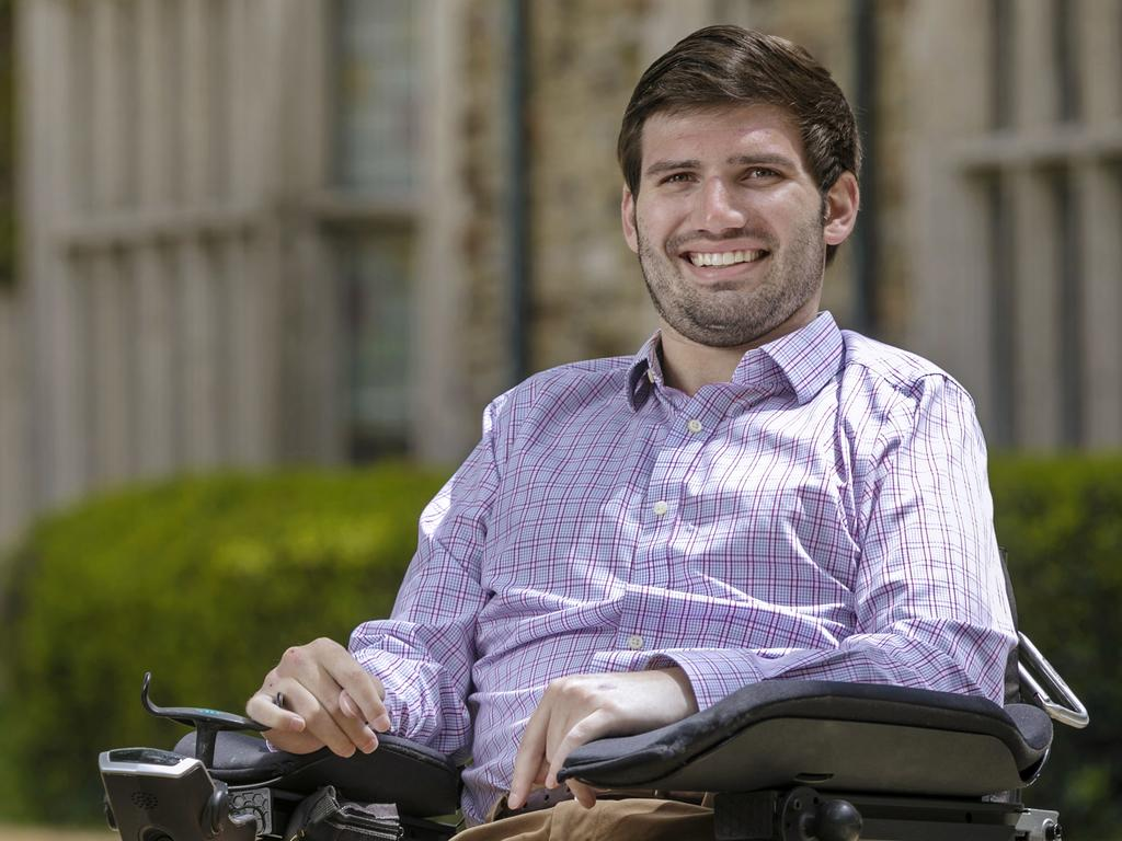 college-aged male sitting in a wheel chair