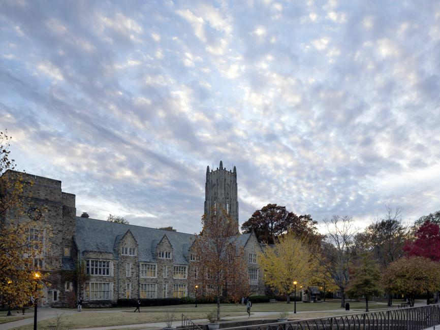 collegiate gothic building with blue sky bursting with clouds