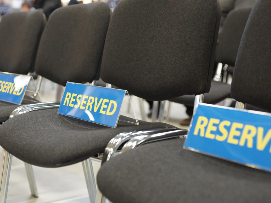 black sets with blue reserved seating signs on them