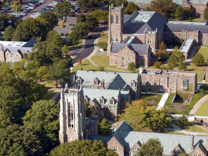 An aerial view of stone academic buildings and their respective quadrangles