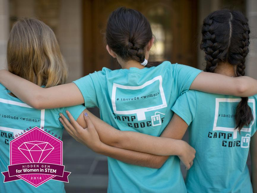 "three girls embracing each other, wearing T-shirts with the words ""included women"""